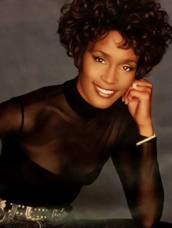 Whitney Houston...Such a beautiful woman with the greatest smile and the voice that knocked the world to it's knees.                                                                                                                                                      More