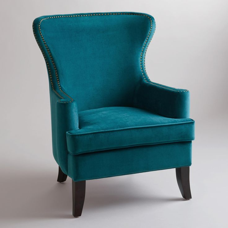 World Market Pacific Blue Elliott Wingback Chair.  Also comes in Nutmeg (burnt orange).  Pacific Blue chair is more green/dusty blue/charcoal in person.