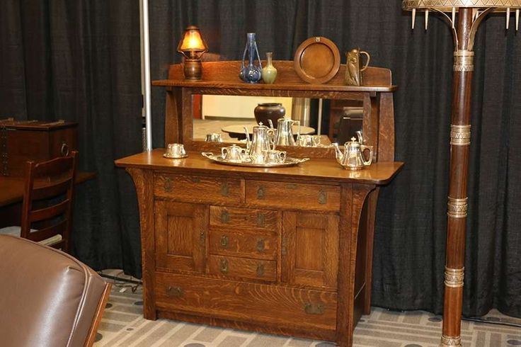 California Historical Design at Craftsman Weekend 2016 | Fantastic Limbert sideboard with mirror and long corbels under top. Excellent original finish. Top surface refinished. Signed. 60″w x 57.5″h x 23″d; Large Kalo hand-hammered sterling silver six piece coffee and tea service. Signed. Excellent condition. Tray measures 24″w x 13″d. Coffee pot measures 8.75″h; John L. Wilocx hammered copper & mica barrel-shaped boudoir lamp. Unsigned. Bottom of lamp has Dirk van Erp – influenced spott