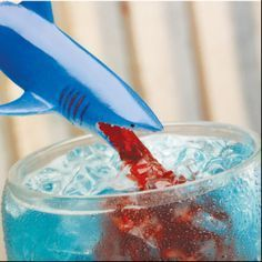 """Joe's Crab Shack """"Shark Bite"""" drink copycat recipe:   0.5 oz Blue Curacao  3 drops Grenadine  0.75 oz Spiced Rum  0.75 oz Light Rum  1.5 oz Sweet and Sour mix  Directions: Mix together with crushed ice in a glass and garnish with mint leaves"""