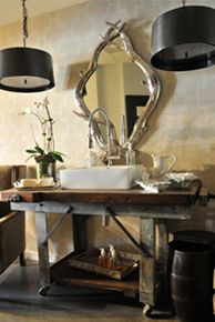 Love the use of old tables as sinks! Perfect for a guys bathroom