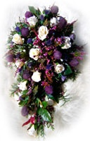 My daughter's Scottish wedding bouquet, with heather, thistles, & cream roses.