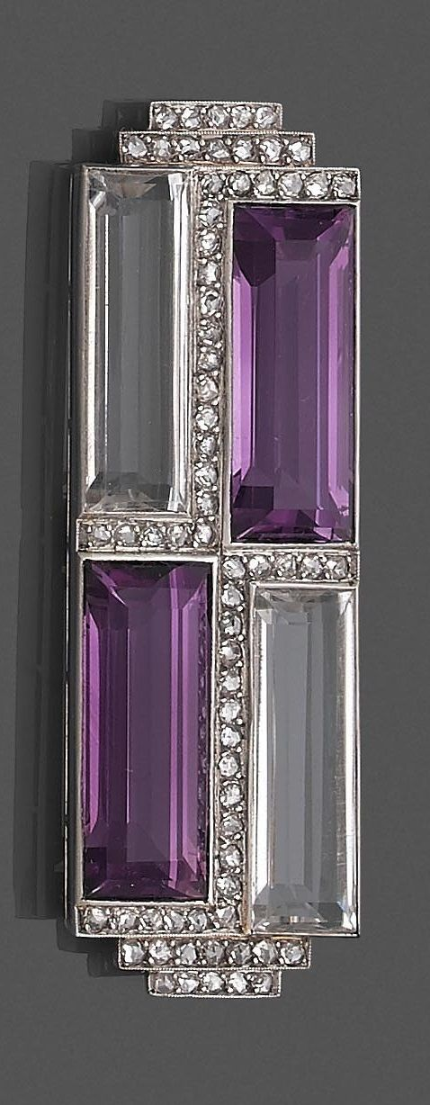 A. Ecalle - An Art Deco platinum, white gold, diamond, amethyst and rock crystal brooch, circa 1930.