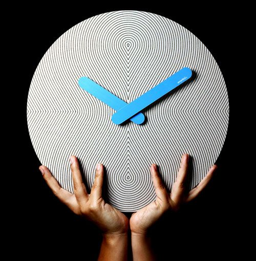 Designed and handcrafted in Colombia by 2y1dea, the eco-friendly Pensamientos is a cardboard and paper wall clock with thin, dizzying line patterns on the faces. Each clock name and pattern was inspired by music that comes specifically from the region, which gives each one its own look and personality.