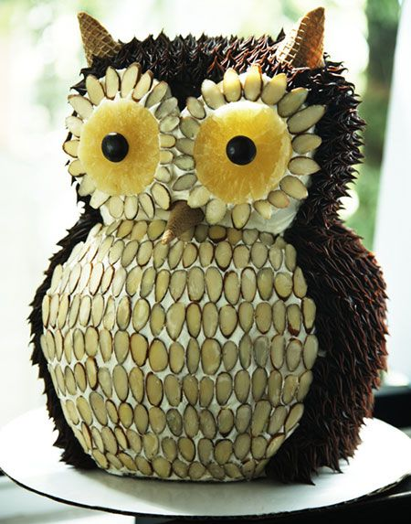 "Owl Cake with dried pineapple/junior mint eyes, slivered almond feathers, and sugar cone ""ears""/beak"