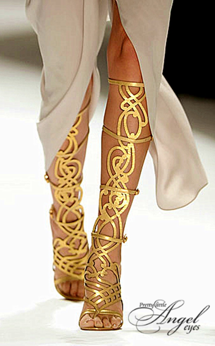 Golden gladiator sandals on the runway.