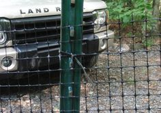 Our dog fence is nearly 200 ft. long and wraps almost completely around our cabin. That's me and Gracie checking out the netting, you can ba...