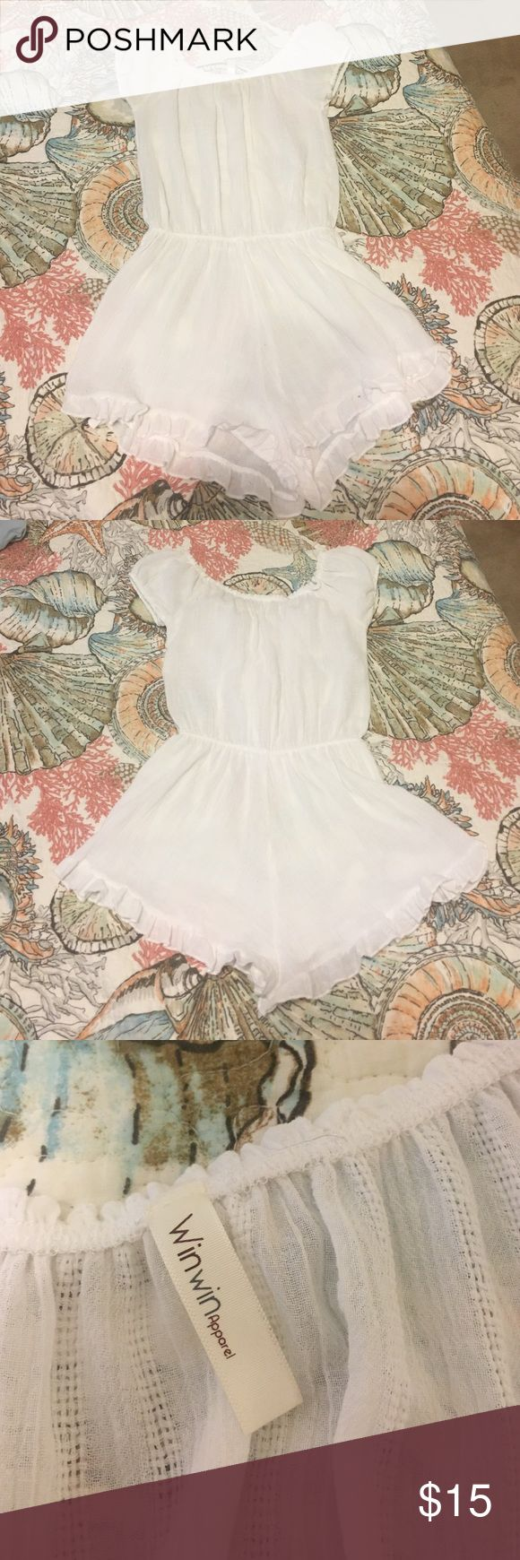 White bathing suit cover up romper! Super cute!! Brand new without tags! It is very light material, which makes it slightly see-through. Perfect for over a bathing suit! Swim Coverups