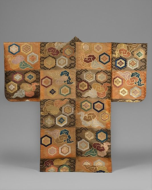 Noh Costume (Atsuita) with Clouds and Hexagons.  Period: Edo period (1615–1868). Date: 19th century. Culture: Japan. Medium: Silk twill damask with silk brocading wefts and supplementary weft patterning in metallic thread. Dimensions: Overall: 65 x 55in. (165.1 x 139.7cm).