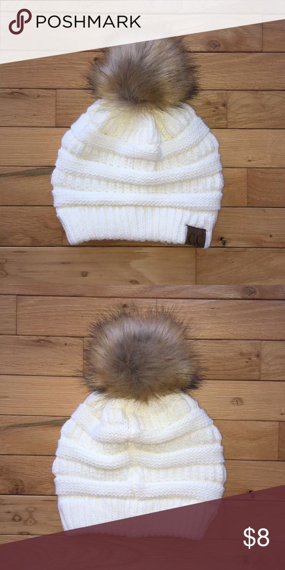 C.C. Cream Beanie Never worn before! Cream with fur Pom on top C.C. Accessories Hats