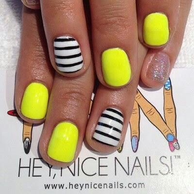 neon nails with black and white stripes
