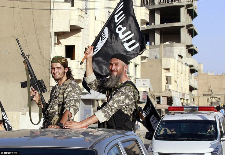 On the frontline: ISIS fighters wearing green camouflage uniforms known as the 'Afghani ro...