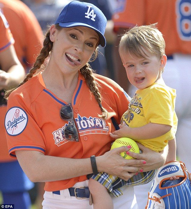 Funny faces: Alyssa repersented her beloved Los Angeles Dodgers on the field as she and Milo goofed around for the cameras.