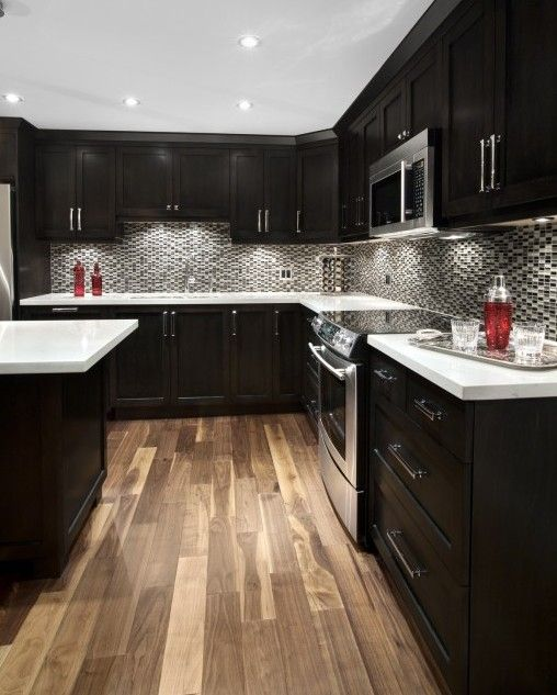 Espresso kitchen cabinets, love them.... Not too crazy about the back splash though it's a little too busy for me.