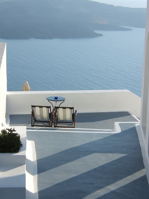 Balconies are great for outdoor decor projects. You can get a modern, retro, mid-century or even eclectic balcony mood. Use chairs, tables, floor lamps... Be creative and find more good home design ideas here: http://www.pinterest.com/homedsgnideas/ Oia village, Santorini island, Greece. - selected by www.oiamansion.com