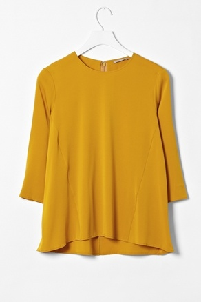 A Detail: A-line shaped side panels inserted for this flow. Great over pencil skirt, as an alternative for peplum style top.