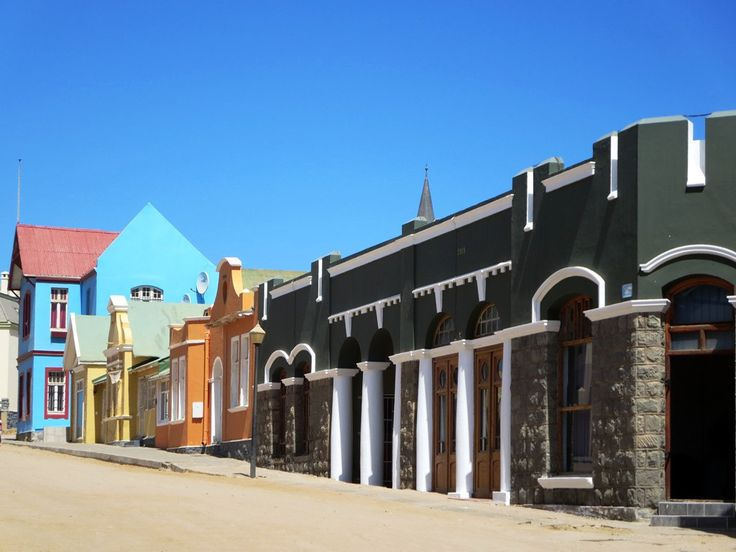 https://flic.kr/p/uoQcSt | Berg Street | German-era buildings line Berg Street in Luderitz, Namibia. Haus Grunewald (1910), the blue building, was the home of the town's first mayor.