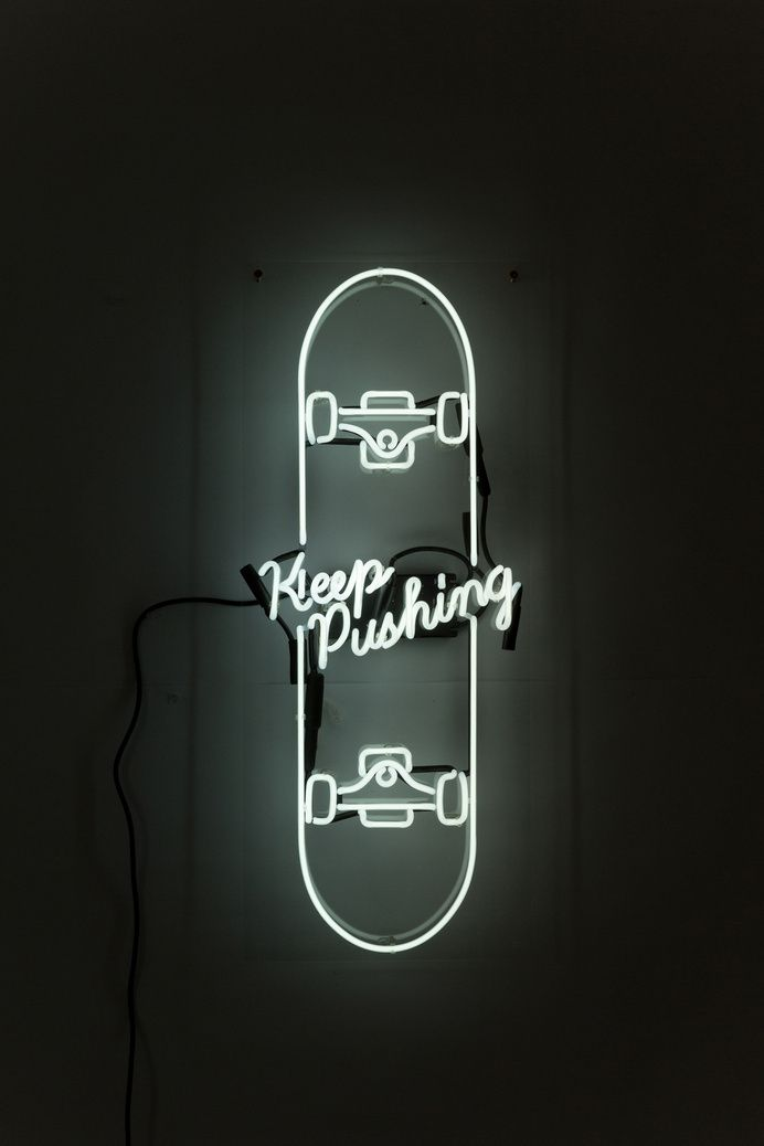 For more inspiration follow on Instagram: THEGYPSETTER Neon sign in the shape of a skateboard. Keep on Pushing.
