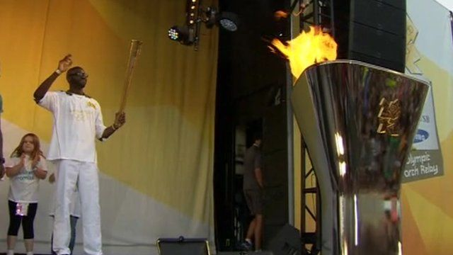 Bolton footballer Fabrice Muamba has carried the Olympic flame as it made its way from Greenwich to Waltham Forest on day 64 of the torch relay.