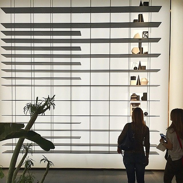 An impressive backlit wall with impossibly thin and elegant shelving at #Molteni @moltenidada, who are celebrating their 80th this year. #Yellowtrace #YellowtraceProductDesign #SaloneDelMobile2015 #ISaloni2015 #MILANTRACE #MILANTRACE2015