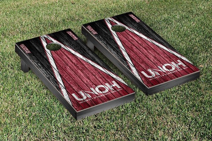 A bean bag toss lawn game complete with a University of Northwestern Ohio Racers style cornhole board, team color duck cloth bags with team logos filled with corn kernels and carrying case. Built to t
