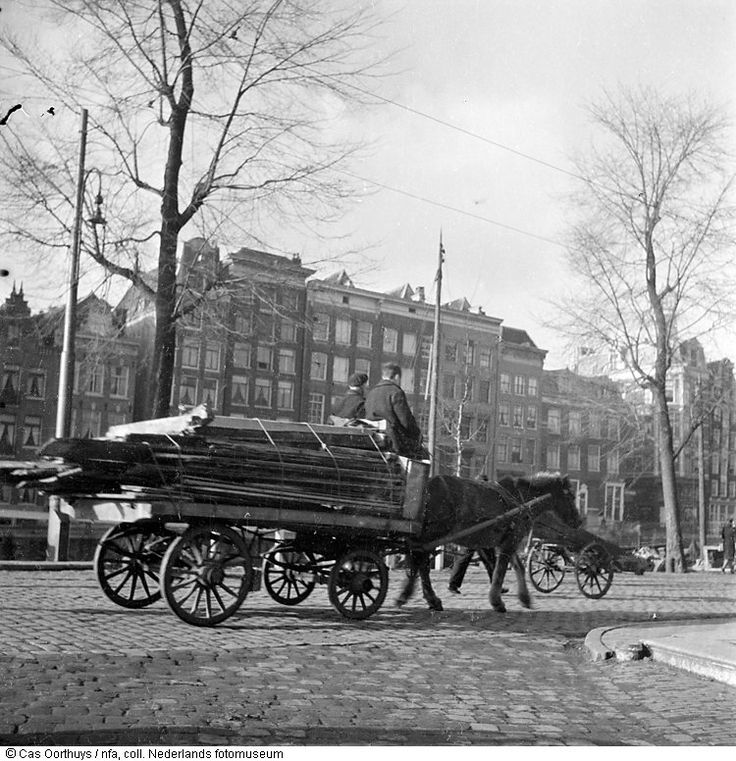 1944 - 1945. Two citizens of Amsterdam transporting firewood during the hunger winter. During the Winter of 1944-1945, Dutch rail workers went on strike to stop the Germans, who then punished them by putting a hold on all maritime transport. This cut off all food and fuel delivery. More than 20,000 people lost their lives in Amsterdam and the western part of the Netherlands during the winter of 1944-1945. #amsterdam #worldwar2