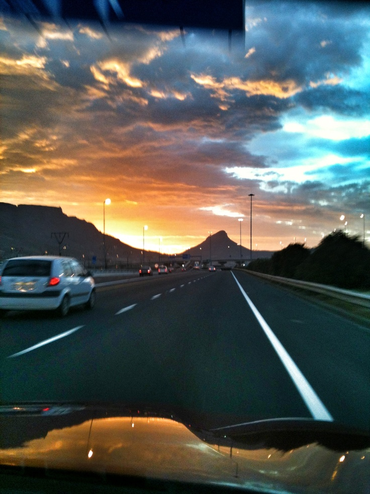 Stunning sunset over Table Mountain and Lions Head, taken while driving...