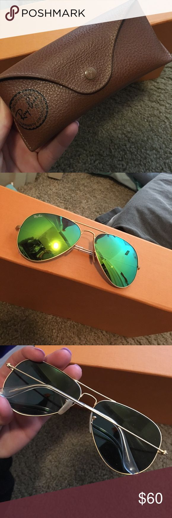 Ray Ban aviator sunglasses Authentic ray bans, green lenses, a couple scratches, but not very noticeable. Comes with case. Ray-Ban Accessories Sunglasses