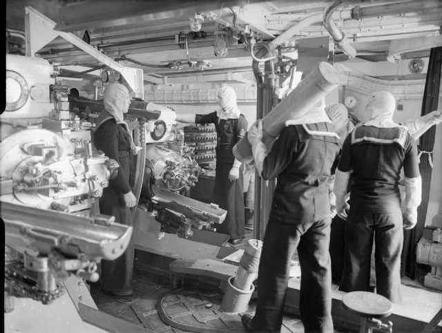 [800 x 603] The interior of a 6-inch triple Mark XXIII mounting on board HMS Jamaica. The crew is wearing anti-flash gear and the crewman in the foreground has over his shoulder a 30-pound (14 kg) cordite propellant charge - Imgur