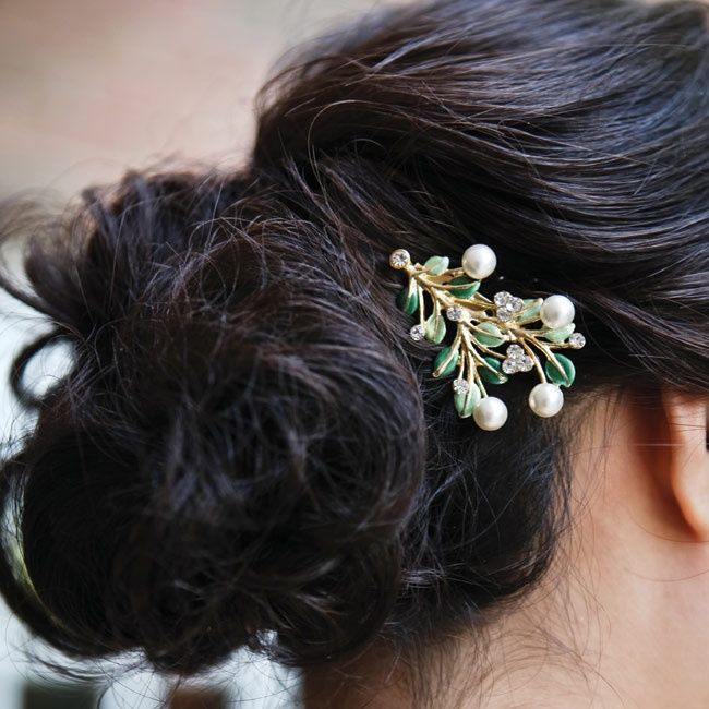 Low updo with Branch Hair Accessory // // photo by: First Comes Love Photo // Hair Stylist: Posh Hair & Makeup Studio