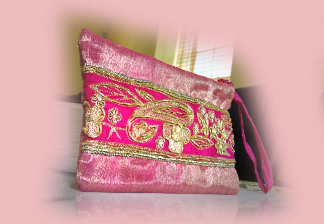 Hand made from an old silk saree pink Rose clutch. Easy to carry, and fits your essentials.  www.epicmart.ca