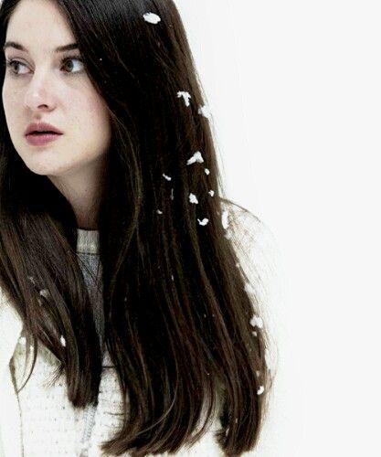 Shai in white bird in a blizzard