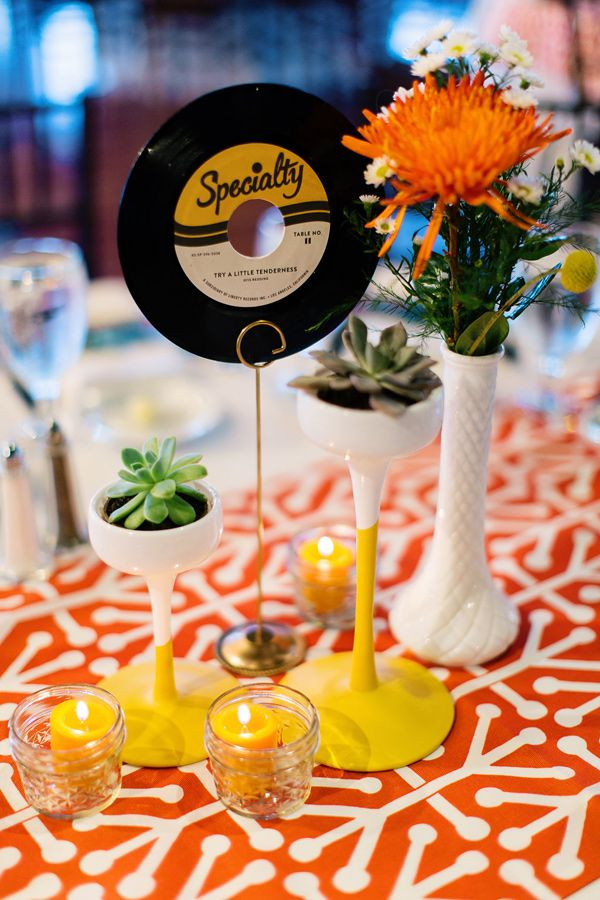 vinyl album centerpiece - photo by Christina Karst Photography http://ruffledblog.com/retro-1960s-wedding-in-st-augustine #centerpieces #weddingideas