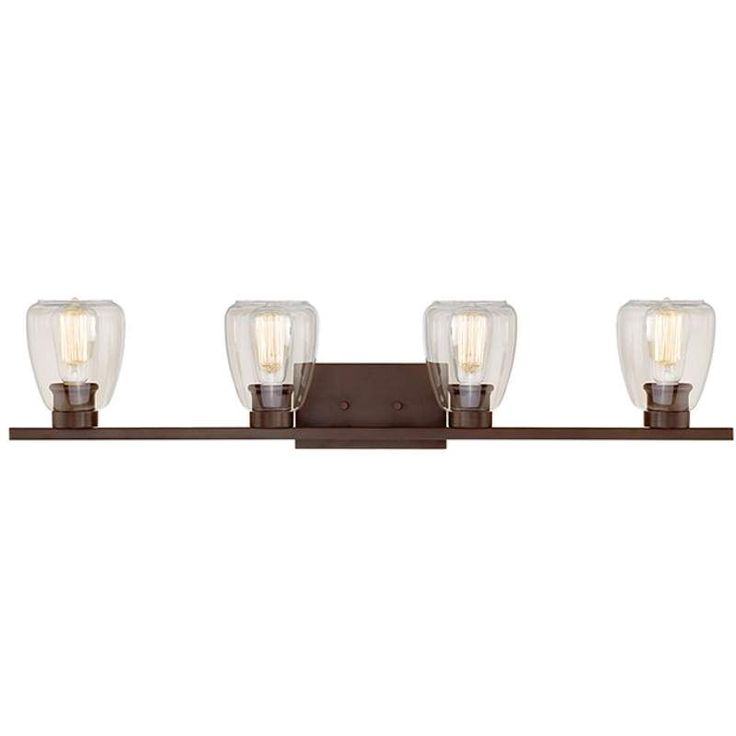 """View the Millennium Lighting 364 4 Light 34"""" Wide Vanity Light with Clear Shades at LightingDirect.com."""