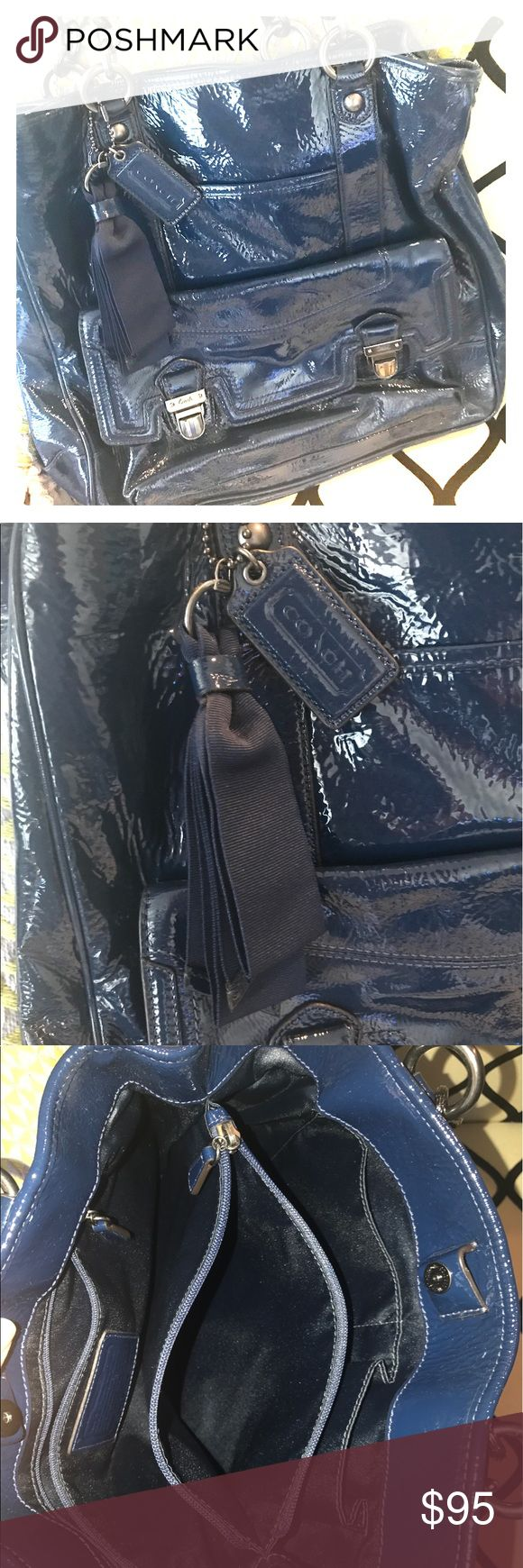 """Navy Blue COACH Hobo Bag Navy Blue Coach with no signs of wear. This purse is really nice with three (3) large pockets inside with the middle being a zipper. It also has wide outside pocket with snap buttons and an inside phone pocket. The detail from the pewter color chains which hang from the straps to the shiny navy blue color make this purse a """"looker"""".  Type:Hobos Measurements:13""""L x 21""""H x 13""""W Color:Navy Brand:Coach Fabric:Navy Pat and Blue Leather Style/Collection:G1169-18717 Style…"""