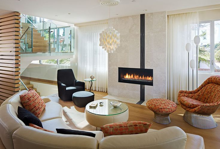A curved sofa focused on the fireplace helps to define the living area.