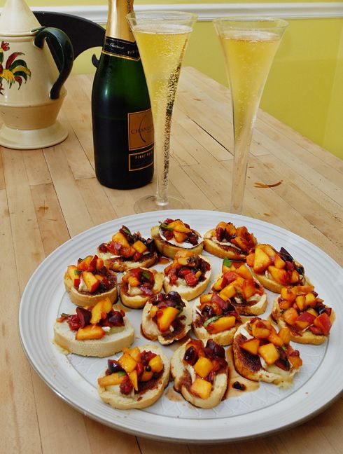 Cherry and peach bruschetta on brie crostini with port reduction sauce