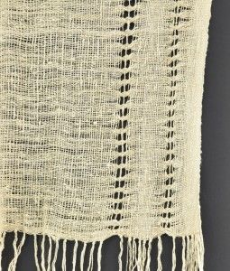 Vertical leno in a wild-silk scarf from Madagascar (Cloth Roads). Groups of weft threads are crossed and held in place by needleweaving in a warp thread after the woven scarf comes off the loom.