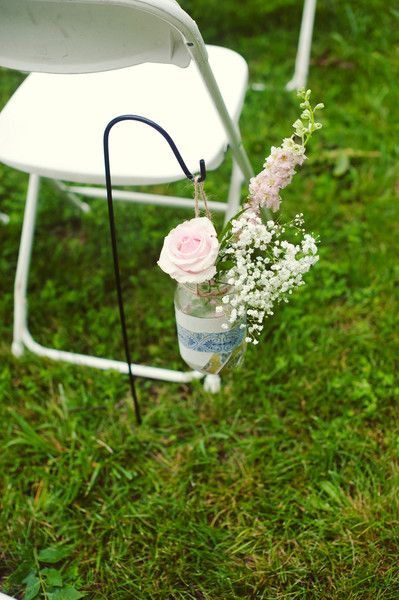We love how each jar that held the floral aisle markers was decorated differently! {Melissa Copeland Photography}