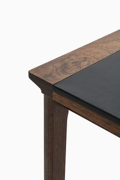 Side table in rosewood and black leather designed by Hans ...