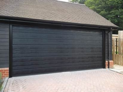 3 - 40mm Insulated Sectional Garage Door fully finished in Black fitted in Ascot, Berkshire. We fitted the Door with the Carteck 250.2 Electric Door opener for ease of use.