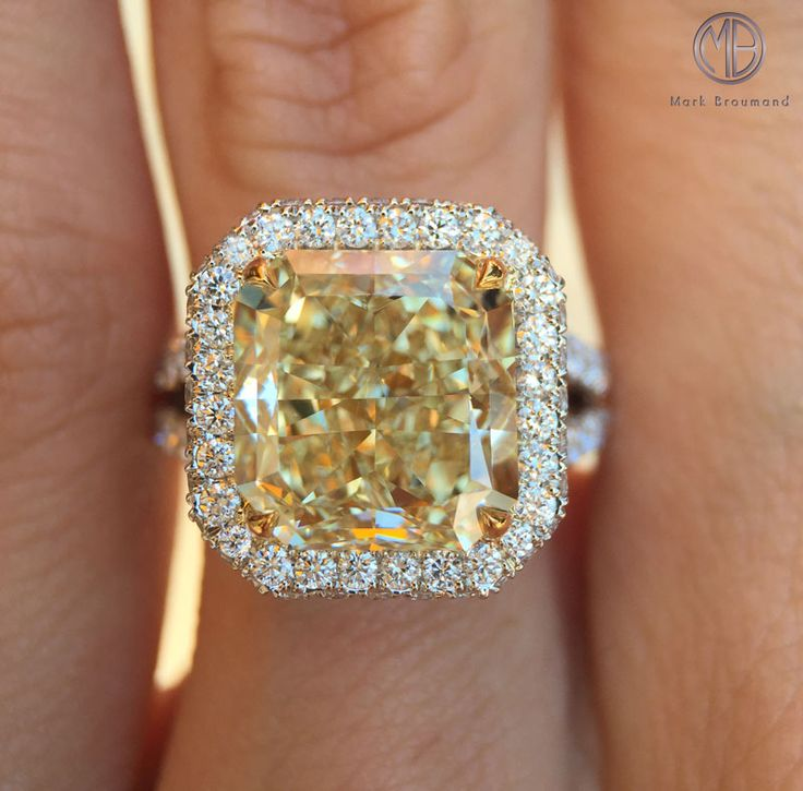 This extraordinary, 6.58ct one-of-a-kind fancy yellow diamond ring will dazzle you!
