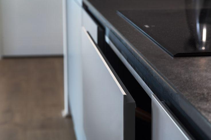 Arrital cabinetry featuring stepped door profile with Fenix NTM door finish