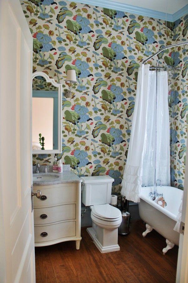 Love the impact of a fun wallpaper in a small bathroom for Bright bathroom wallpaper