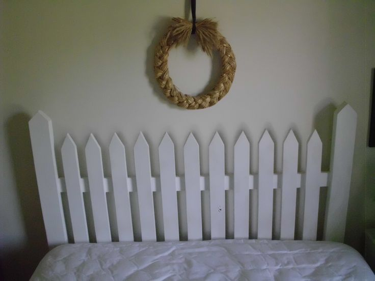 Picket fence headboard created from used porch wood.