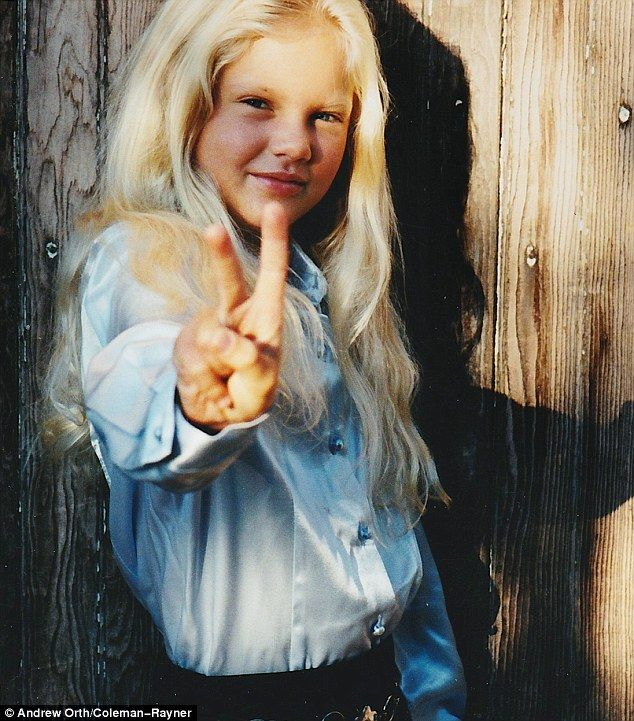 Peace out: Taylor, six, was confident in front of the camera at a young age