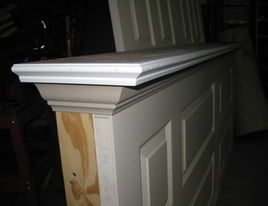 if using an old door, attach a 2x4 perpendicular to it at the end, then top with moulding to finish off.