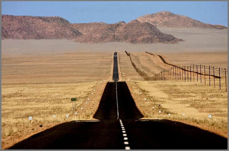 """69 to Aus"" This is the tar road between Luderitz and Aus in Namibia with the railway track running alongside on the right."