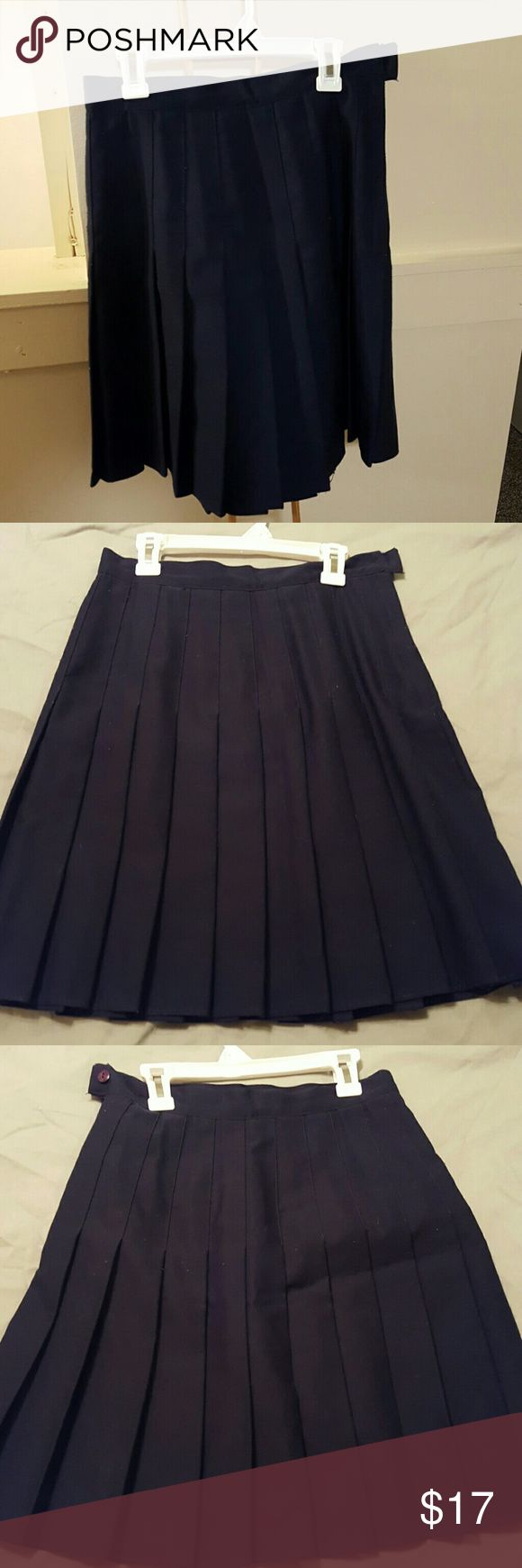 Navy blue pleated skirt Navy blue skirt sits just about knee length. Great for the office or as a uniform. Like new condition, side zipper. 35th & 10th Skirts