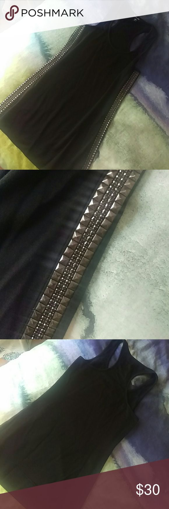 Bebe Studded Racer Tank Top So edgy and punk rock! This racerback tank top is made out of French Terry sweatshirt type material and features multiple rows of pyramid studs and small black rhinestones down the sides. Super cute with boots and leggings! bebe Tops Tank Tops